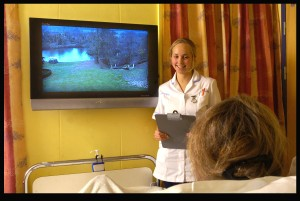 A Room with a View. Auxiliary Nurse Lucy Woodward demonstrates Dorset County Hospital's new £50,000 'Room with a view' for cancer patients who have to spend long periods in 'clean air' isolation rooms. The unique project beams live pictures via a microwave link from a beauty spot several miles away. (Bournemouth News)